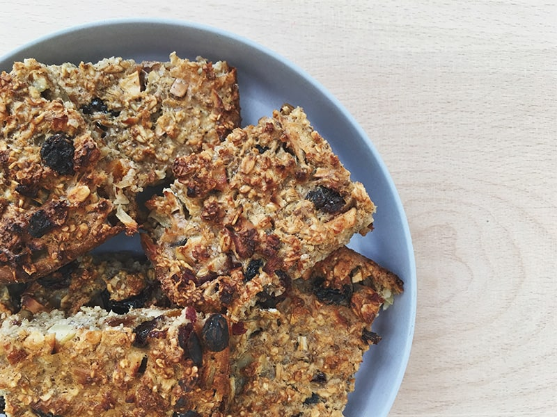 Delicious and nutritious slices of Oaty Bars on a round blue plate
