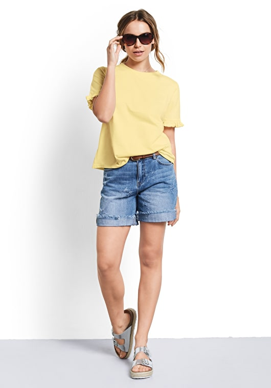 Model wears our Mellow Yellow tee with frilled short sleeves