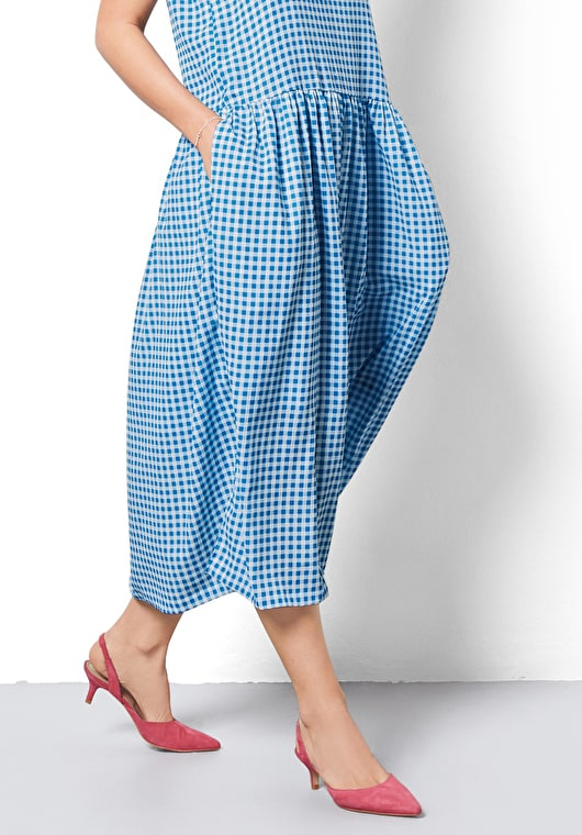 Model wears our loose fitting gingham dress in a stunning french blue and white in a v line neck