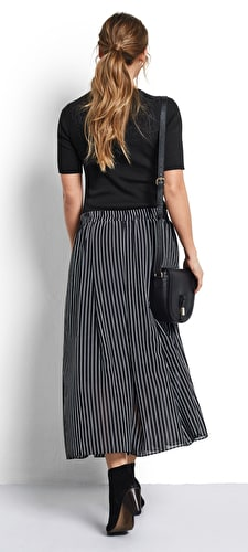 Model wears our Chiffon style floaty maxi skirt in black with white stripes