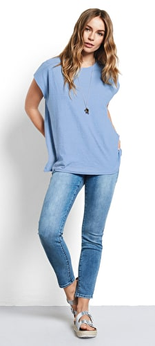 Model wears our Boxy oversized tee with a round neck and short sleeves in placid blue