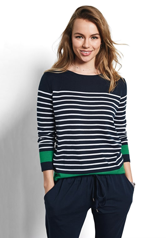 Model wears our supersoft contrast stripe jumper in midnight, white and jolly green