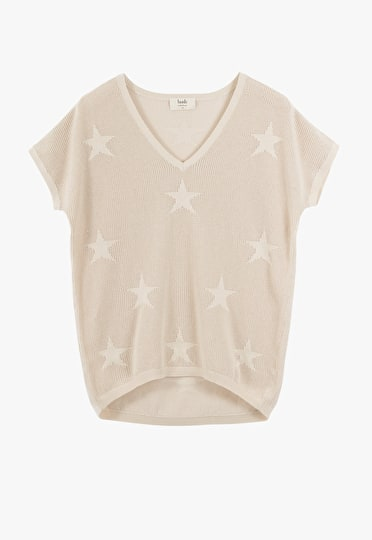 Relaxed v neck with delicate stars knitted into a lightweight yarn in biscuit