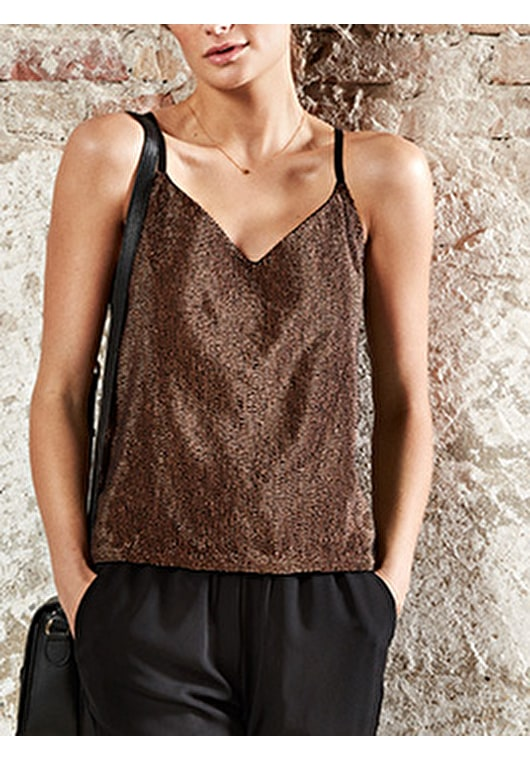 Model wears our Racerback style sequinned top in black and copper
