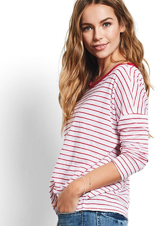Model wears our Long sleeve tee shirt with classic ski red and white stripes