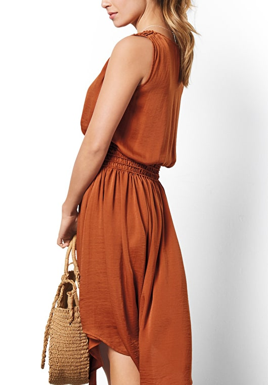 Model wear our stunning Picante dress with a shirred waist line,assymetric dip hem and flattering v neckline