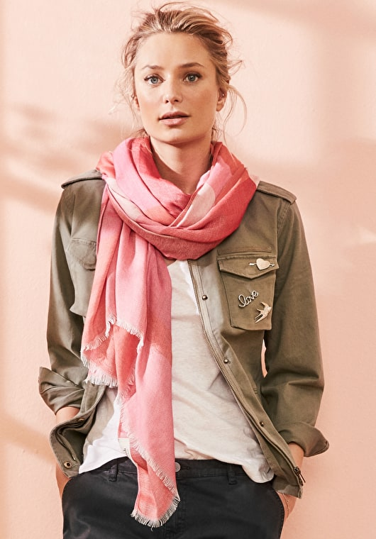 Model wears our Super soft scarf with weaved in colour blocks of multi colours of pink
