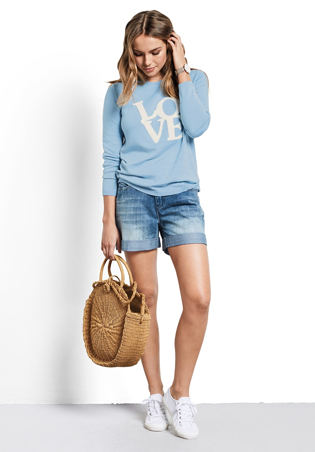Model wears our classic knit with a 60's inspired motif of 'Love' in baby blue and white