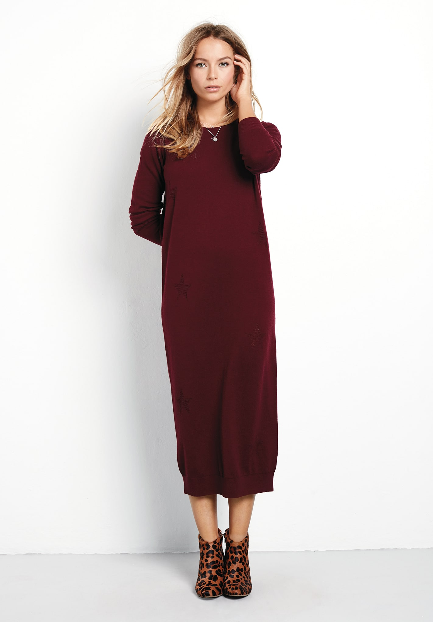 A knit midi dress in soft, organic pima cotton with a touch of spandex for a hint of stretch, and an elastic waist for blouson drape. An always-stylish midi length is all the more flattering with dramatic side slits.