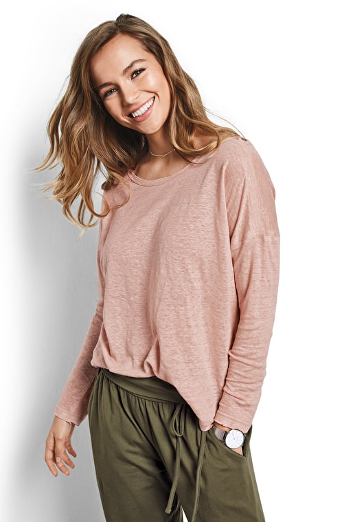 Model wears our Relaxed linen long sleeved tee with raw edge detailing in blush