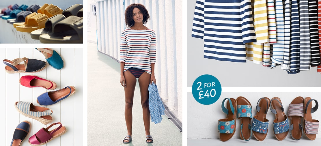 Close ups of new stripey and printed sandals. Girl wearing breton striped shirt in front of a beach hut.