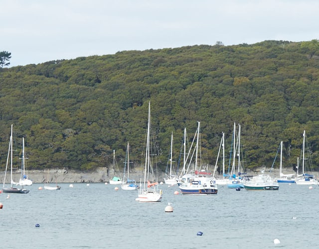 Scenic photo of Boats at the Helford river.