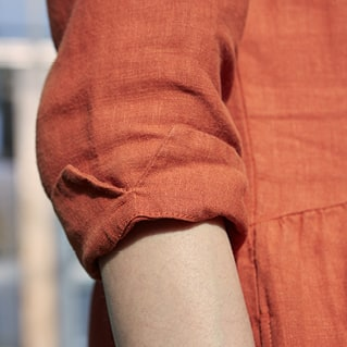 Close up of a tan autumnal tunic sleeve